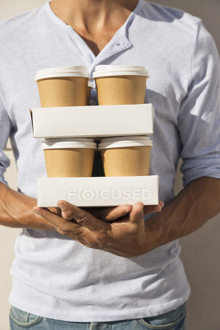 Man carrying take away coffee — Stock Photo