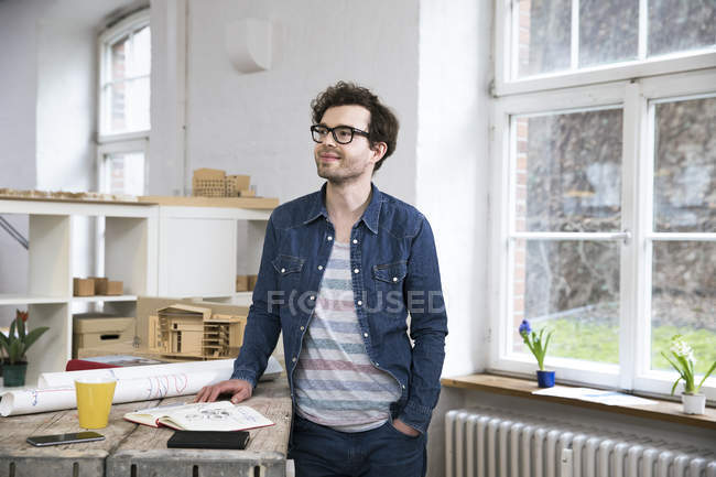 Man standing in creative office — Stock Photo