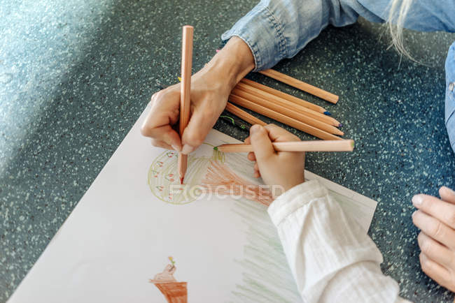Woman and girl drawing together — Stock Photo