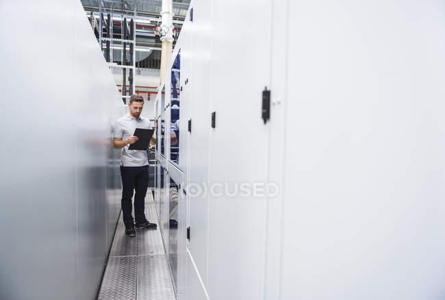 Man examining system in factory — Stock Photo