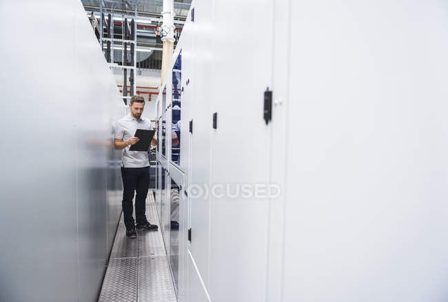 Man examining system in factory — Stock Photo