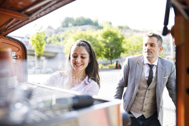 Businessman buying take away coffee — Stock Photo
