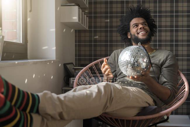 Man holding mirror ball — Stock Photo