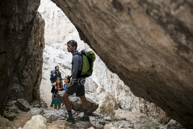Friends climbing rocks in mountains — Stock Photo