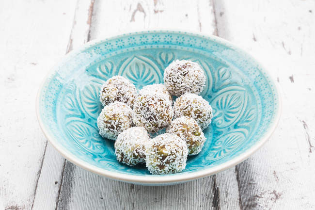 Bliss Balls with dates and coconut flakes — Stock Photo