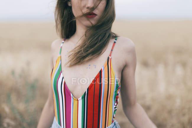 Woman wearing swimsuit standing in field — Stock Photo