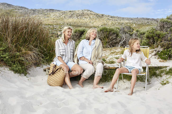 Mother daughter and grandmother at beach — Stock Photo