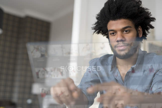 Man working on futuristic screen — Stock Photo