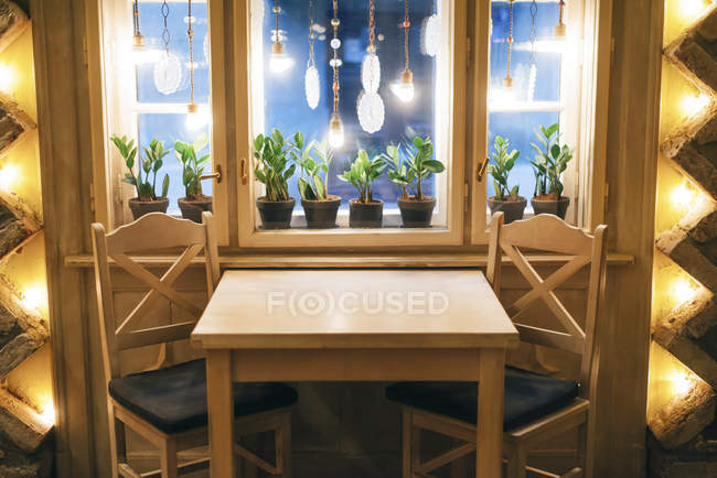 Table with chairs in restaurant — Stock Photo