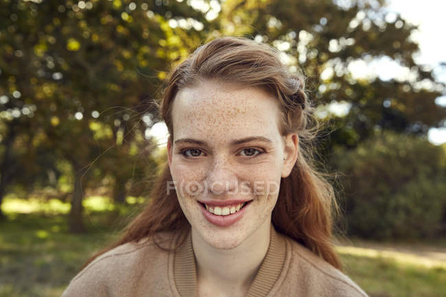 Redheaded young woman with freckles — Stock Photo