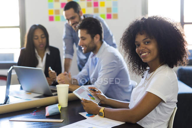 Businesswoman during meeting in office — Stock Photo