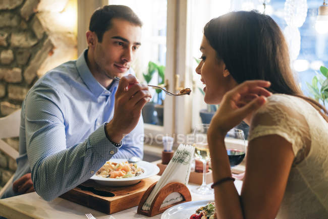 Young couple having dinner in restaurant — Stock Photo
