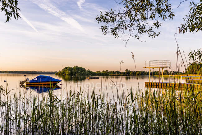 Schaalsee with moored motorboat — Stock Photo