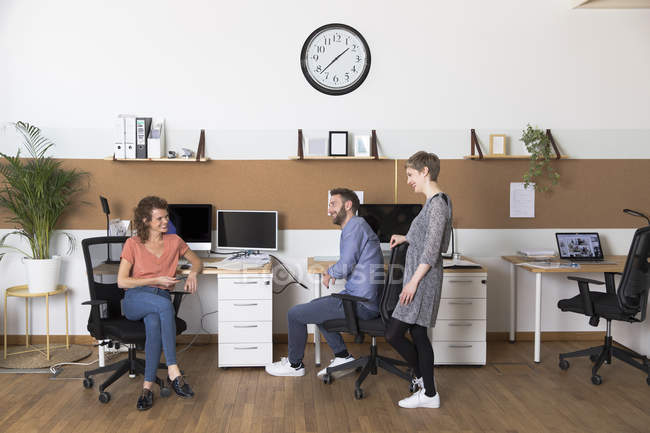 Colleagues in modern office — Stock Photo