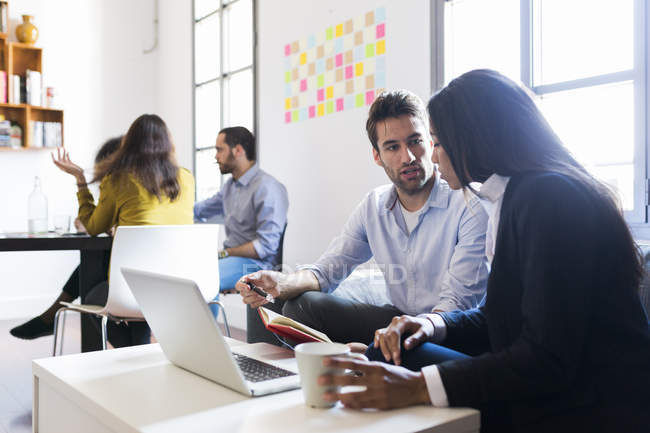 People discussing in office — Stock Photo