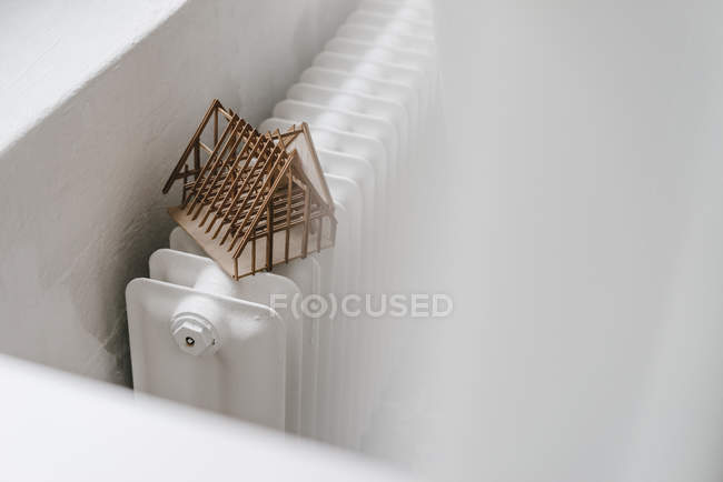 Architectural model on heater — Stock Photo