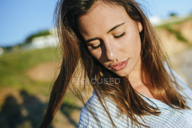 Woman with eyes closed at sunlight — Stock Photo
