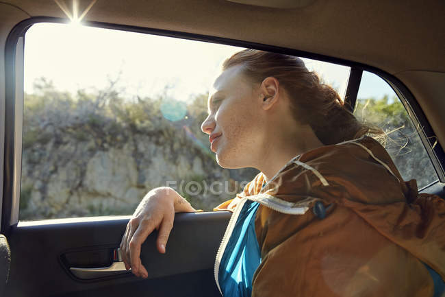 Woman in car looking out of window — Stock Photo