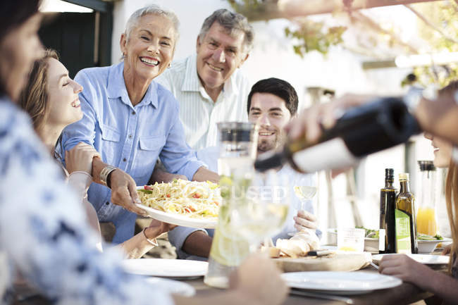 Family having lunch outside — Stock Photo