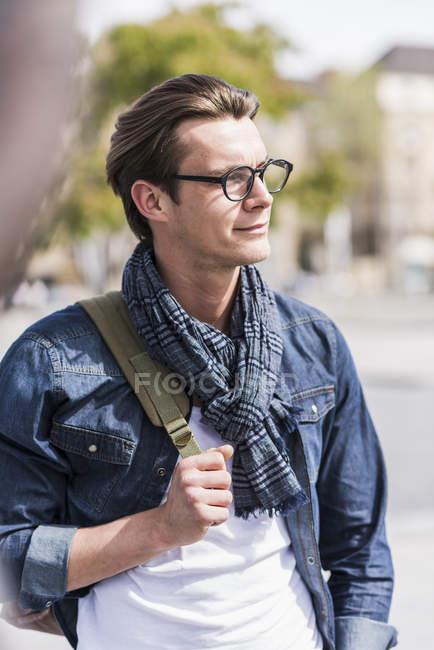Young man walking down street — Stock Photo