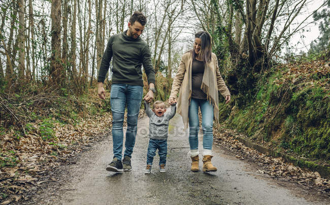 Woman walking with family — Stock Photo