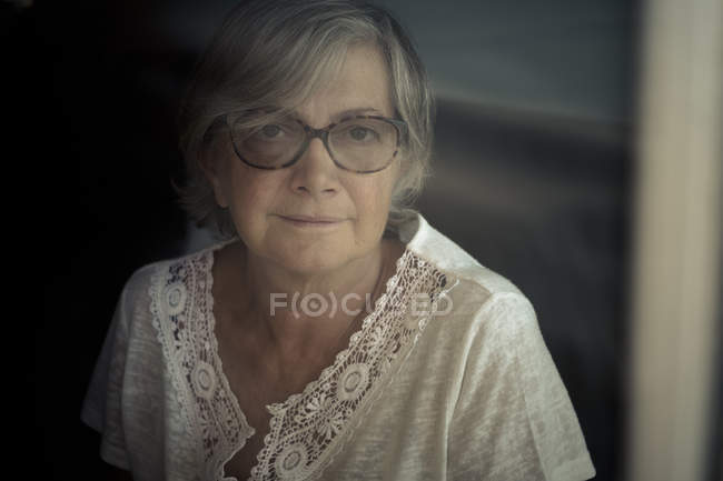 Senior woman looking at camera — Stock Photo