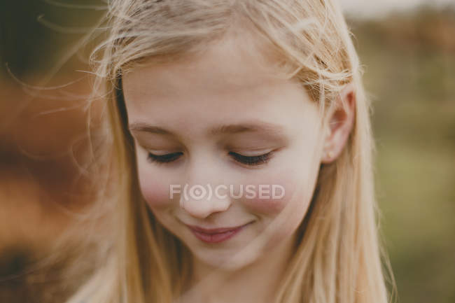 Smiling girl looking aside — Stock Photo