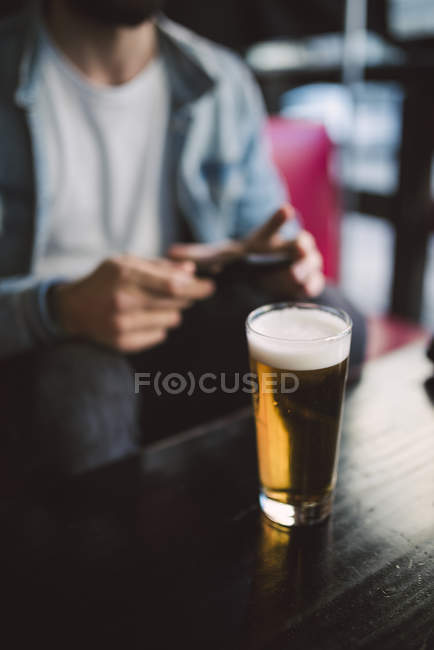 Glass of beer on table — Stock Photo