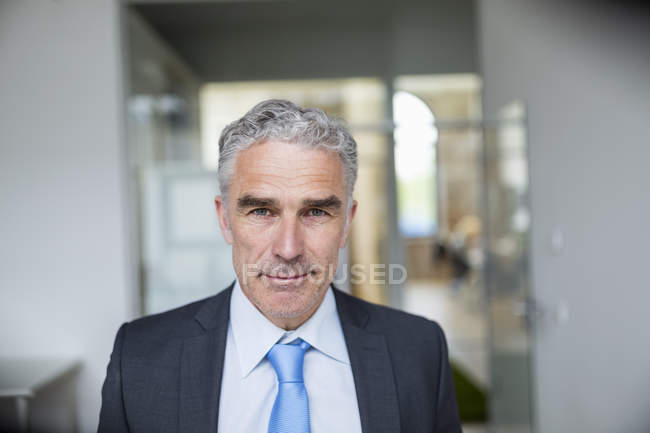 Businessman standing and looking at camera — Stock Photo