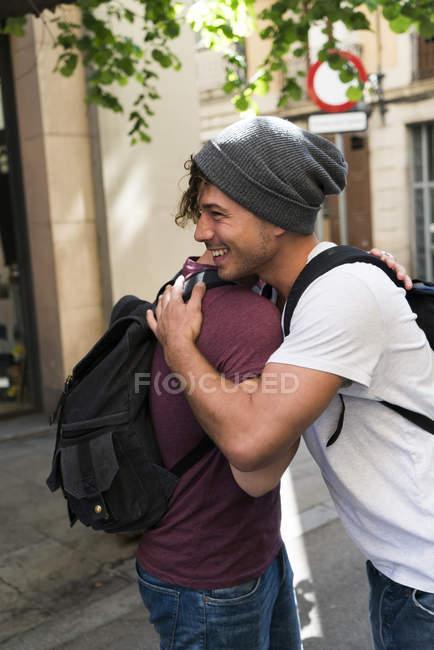 Men embracing saying good bye — Stock Photo