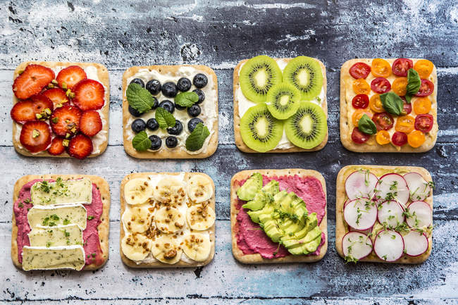 Various garnished sandwiches — Stock Photo