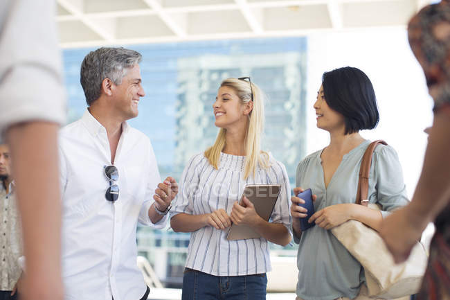 Group of businesspeople socializing — Stock Photo