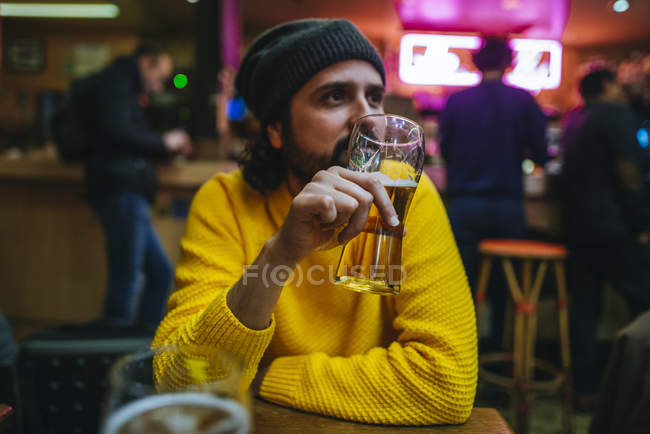 Man with glass of beer in pub — Stock Photo