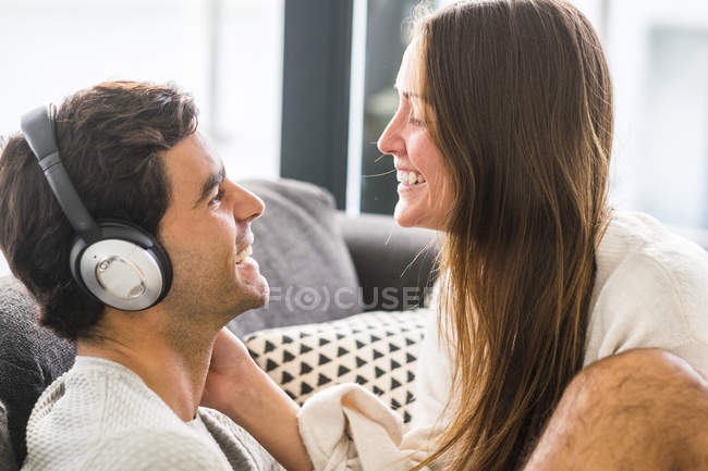 Woman looking at man wearing headphones — Stock Photo