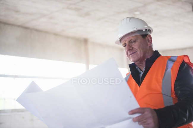 Man examining plan — Stock Photo