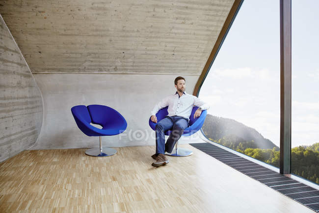 Businessman sitting on chair — Stock Photo
