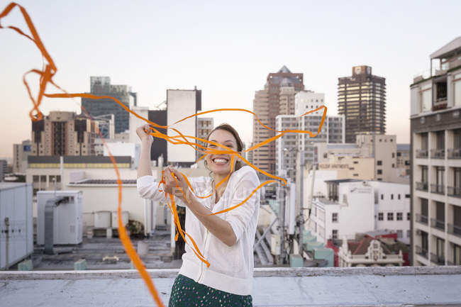 Woman playing with ribbon — Stock Photo