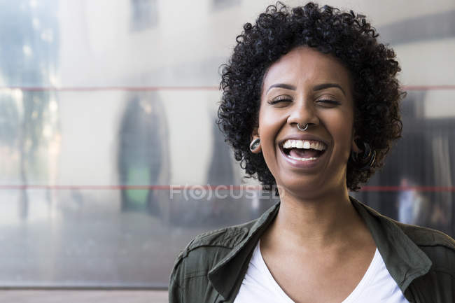 Laughing woman with piercings — Stock Photo