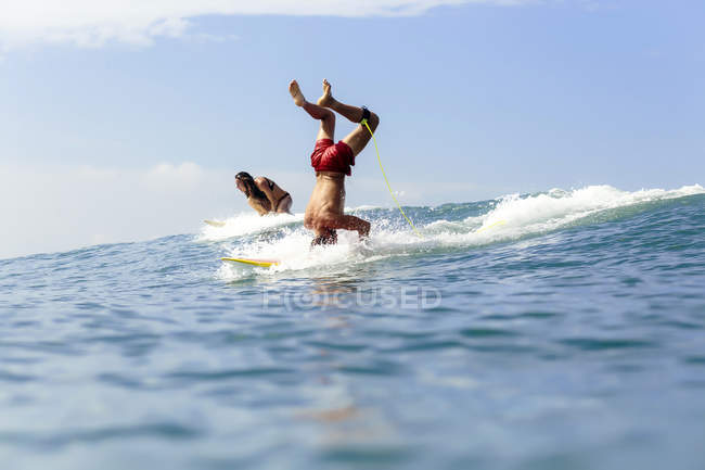 Surfers doing tricks in sea water — Stock Photo