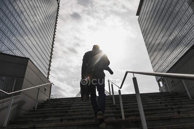 Businessman running upstairs — Stock Photo