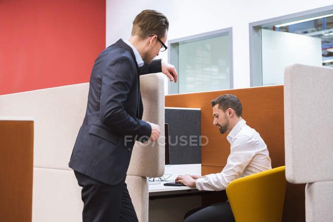 Businessmen discussing in office — Stock Photo