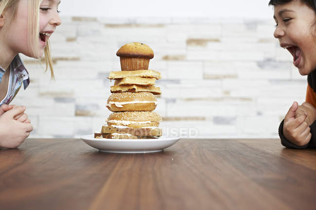 Children with stack of baked pancakes — Stock Photo