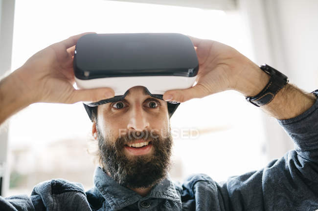 Starring man with Virtual Reality Glasses — Stock Photo