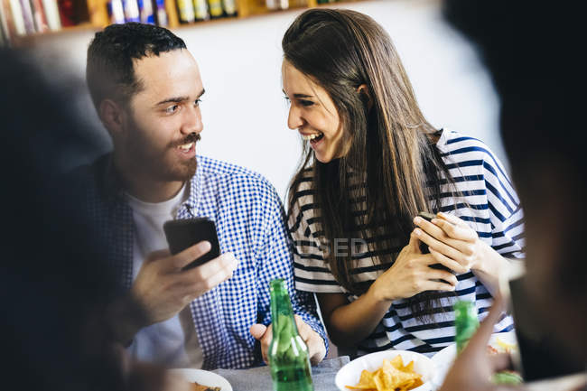 Couple sharing cell phone — Stock Photo