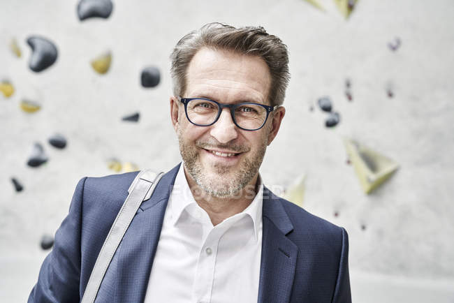 Businessman with stubble wearing glasses — Stock Photo