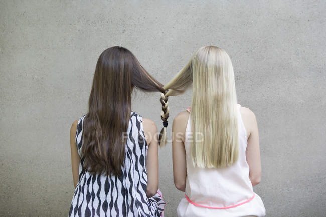 Long-haired girls with one braid — Stock Photo