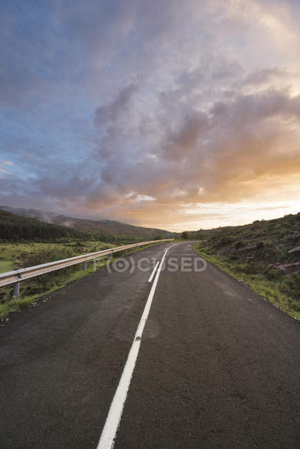 Sunset at a mountain road — Stock Photo