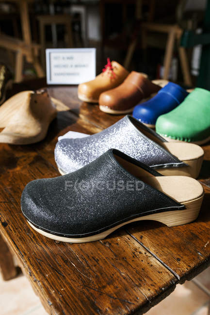 Colorful clogs on table — Stock Photo
