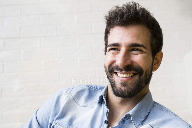 Laughing young man with beard — Stock Photo