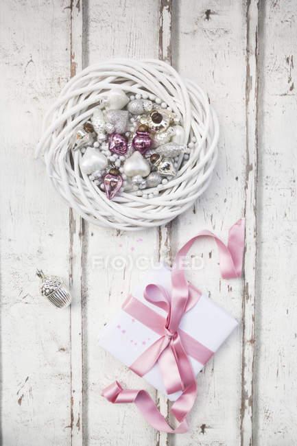Christmas present on wood — Stock Photo
